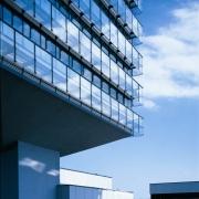 GENO_Haus_neu_Glas_und_Wolken-1
